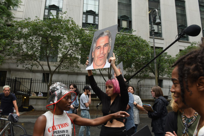 Jeffrey Epstein in front of a New York City